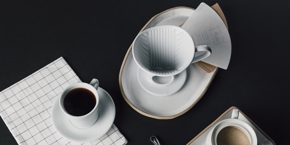 Showing coffee cup and pour over on a table